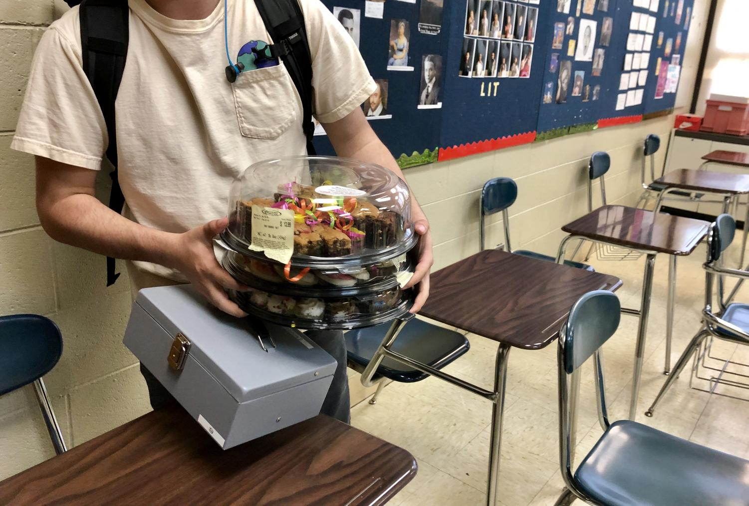 Alek Malone, senior and Ecology Club co-president, sold pastries during class to raise money for Ecology Club.  Raised funds go towards materials and supplies for the school garden.