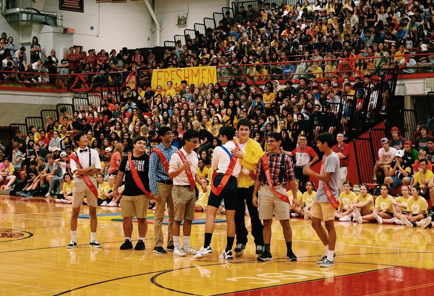 On+Friday%2C+Sept.+20%2C+the+homecoming+court+nominations+assembly+took+place+at+the+school+gymnasium.+The+nominated+seniors+hugged+each+other+down+a+line+to+congratulate+each+other.