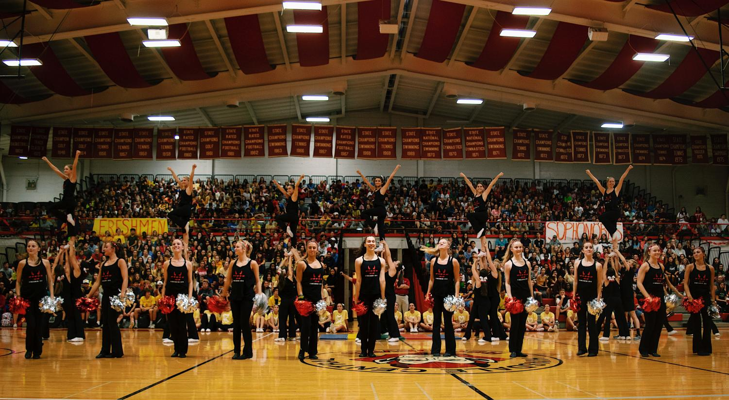 On+Friday%2C+Sept.+20%2C+the+varsity+pommers+danced+during+the+homecoming+court+nominations+assembly+to+a+variety+of+songs.++They+did+many+tricks+such+as+turns+and+a+kick+line.%0A