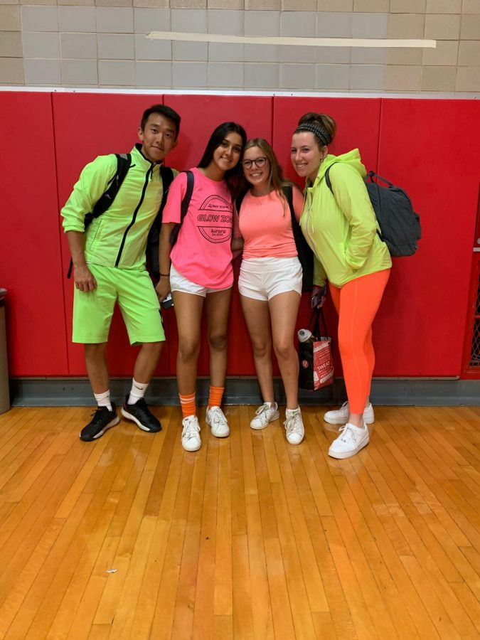 Seniors+Herbert+Wang%2C+Bahar+Abtahi%2C+Isabella+Lorr%2C+and+Alex+Froiland+dress+up+in+neon+for+Friday%27s+dress+day.