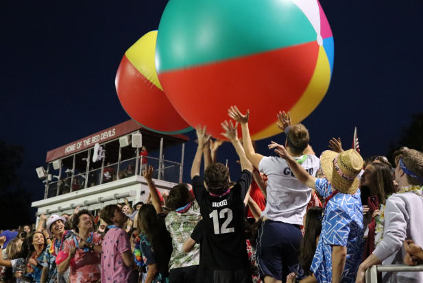 The senior beach-theme colored the student section as they tossed huge beach balls.