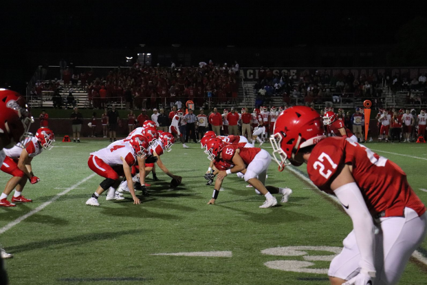 The football team worked together, especially with a  strong defense and offense, to score each touchdown against Naperville Central.