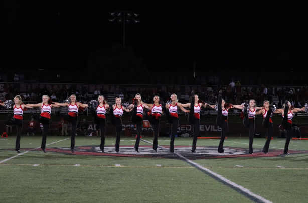 The varsity pommers, along with the band, color guard, and cheerleaders, performed during half-time.