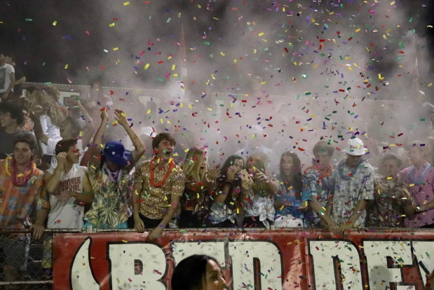The student section celebrated each touchdown with baby powder and confetti.