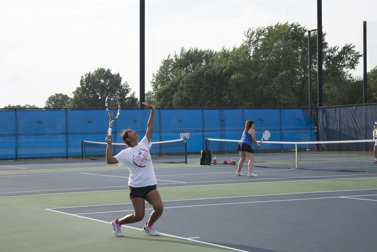 Prachi Shah, freshman, serves the ball in her singles match against her opponent at LT on Tuesday, Sept. 10.