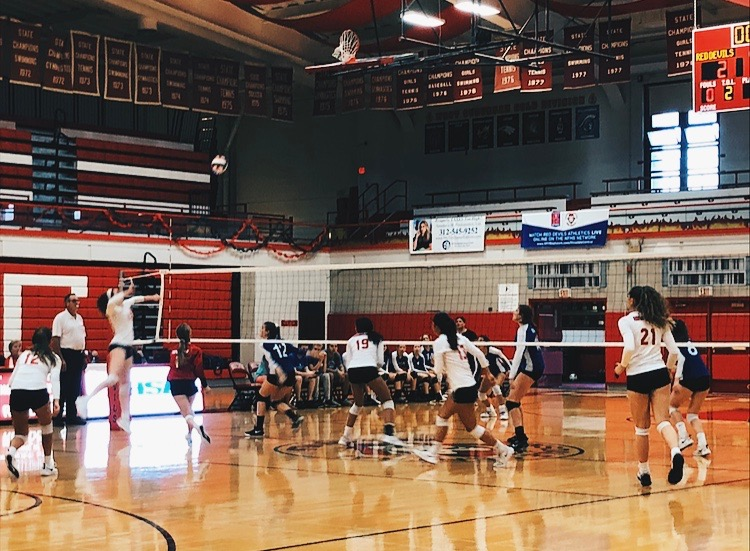 The volleyball team makes an aggressive hit in the first set.