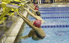 Girls' swim and dive team takes home win against LT