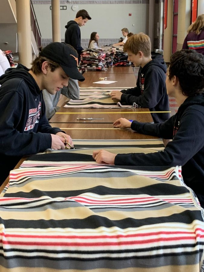 Some students didn´t have to leave Central too volunteer. This group worked in the cafeteria to make scarves for the Backpack project.