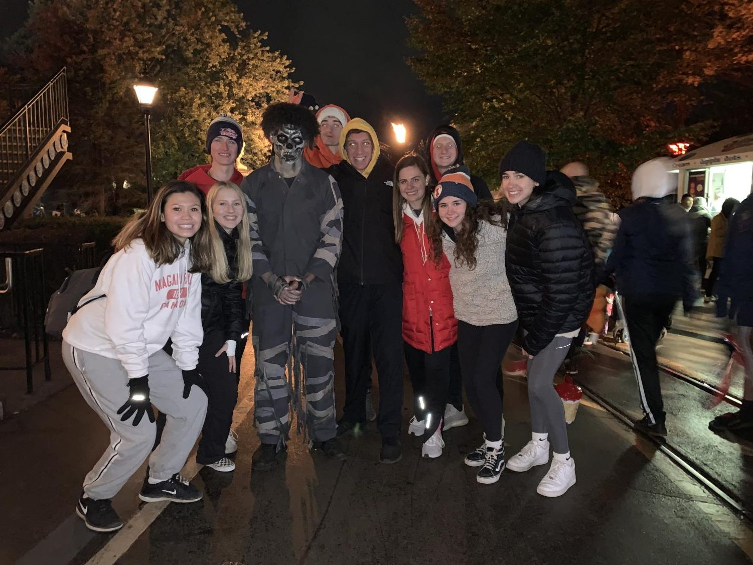 A group of juniors poses with one of the monsters from Fright Fest. These actors are scattered throughout the amusement park and scare any passerby.