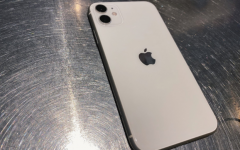 The iPhone 11 in white contains a glossy glass back screen as well as two separate camera lenses for different angles.