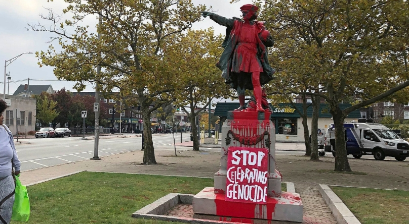 """In Rhode Island and San Francisco, people vandalized statues of Columbus to protest the holiday. On the statue is written """"genocide."""""""