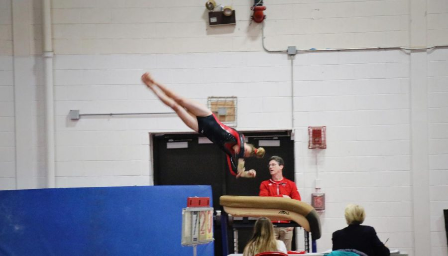 Charlotte French, sophomore, vaults during the Red vs. White gymnastics meet on Friday, Nov. 22.