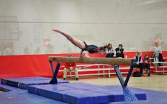Annette Sommers, sophomore, performs her beam routine on Friday, Nov. 22 at the gymnastics meet.