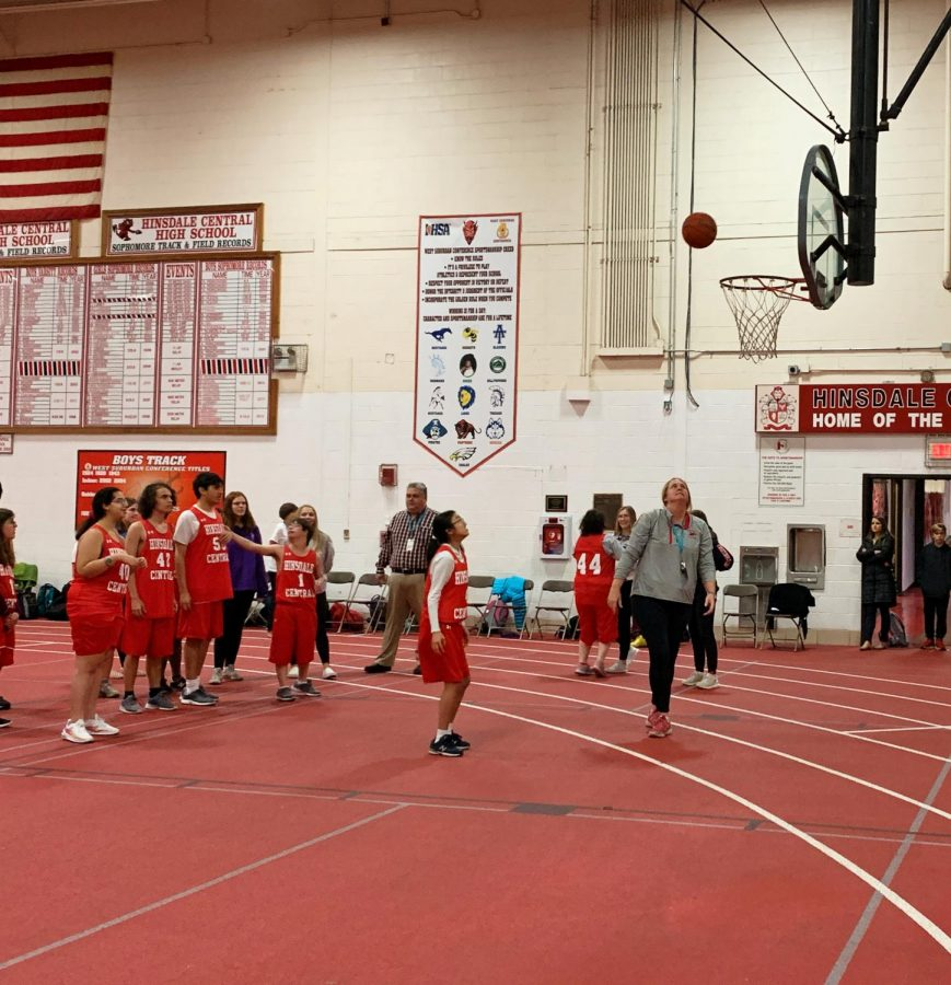 Coach Watson practices drills with the Special Olympics basketball team on Wednesday, Nov. 6.