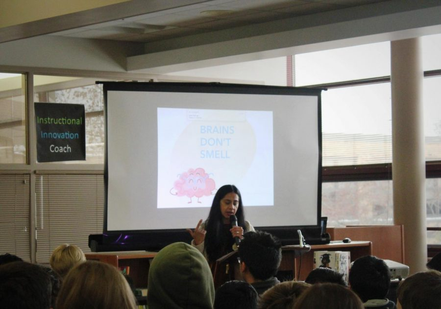 """Author Samira Ahmed begins her presentation by reading her first published piece of writing titled, """"Brains Don't Smell""""."""