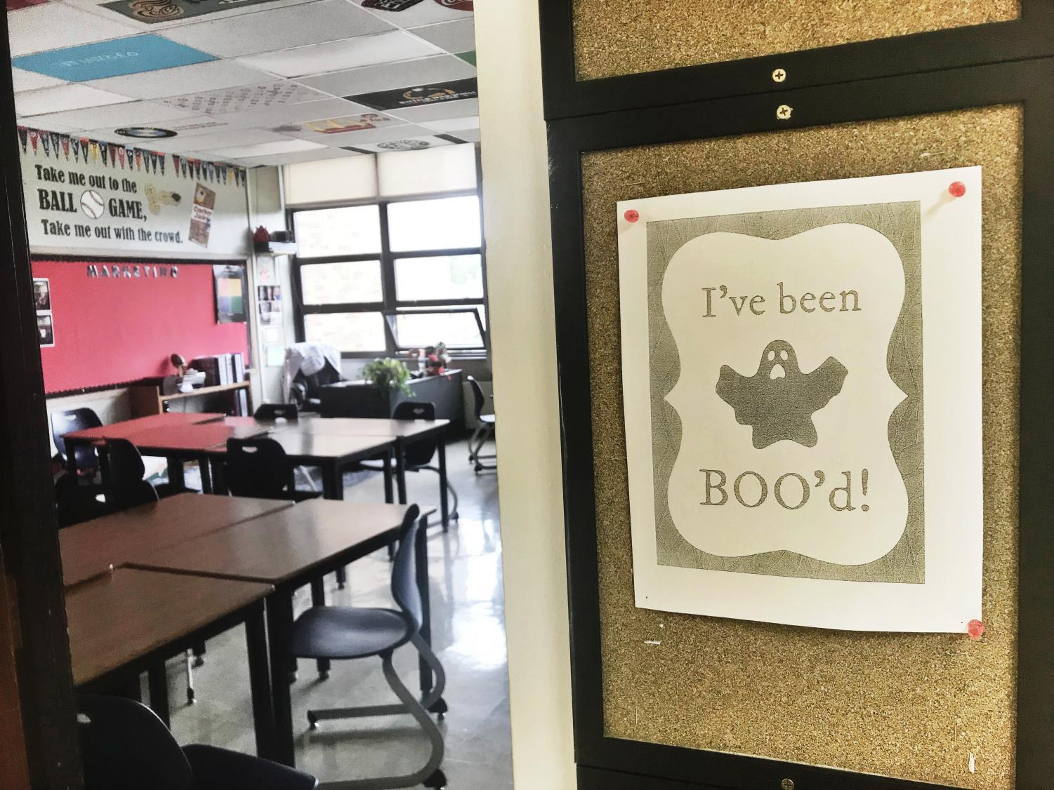 Throughout the entire school, boo'd signs have been left on teachers doors and desks to indicate that they've been boo'd. A large number of boo'd signs have been seen in the school, indicating that many teachers are participating in this Halloween game.