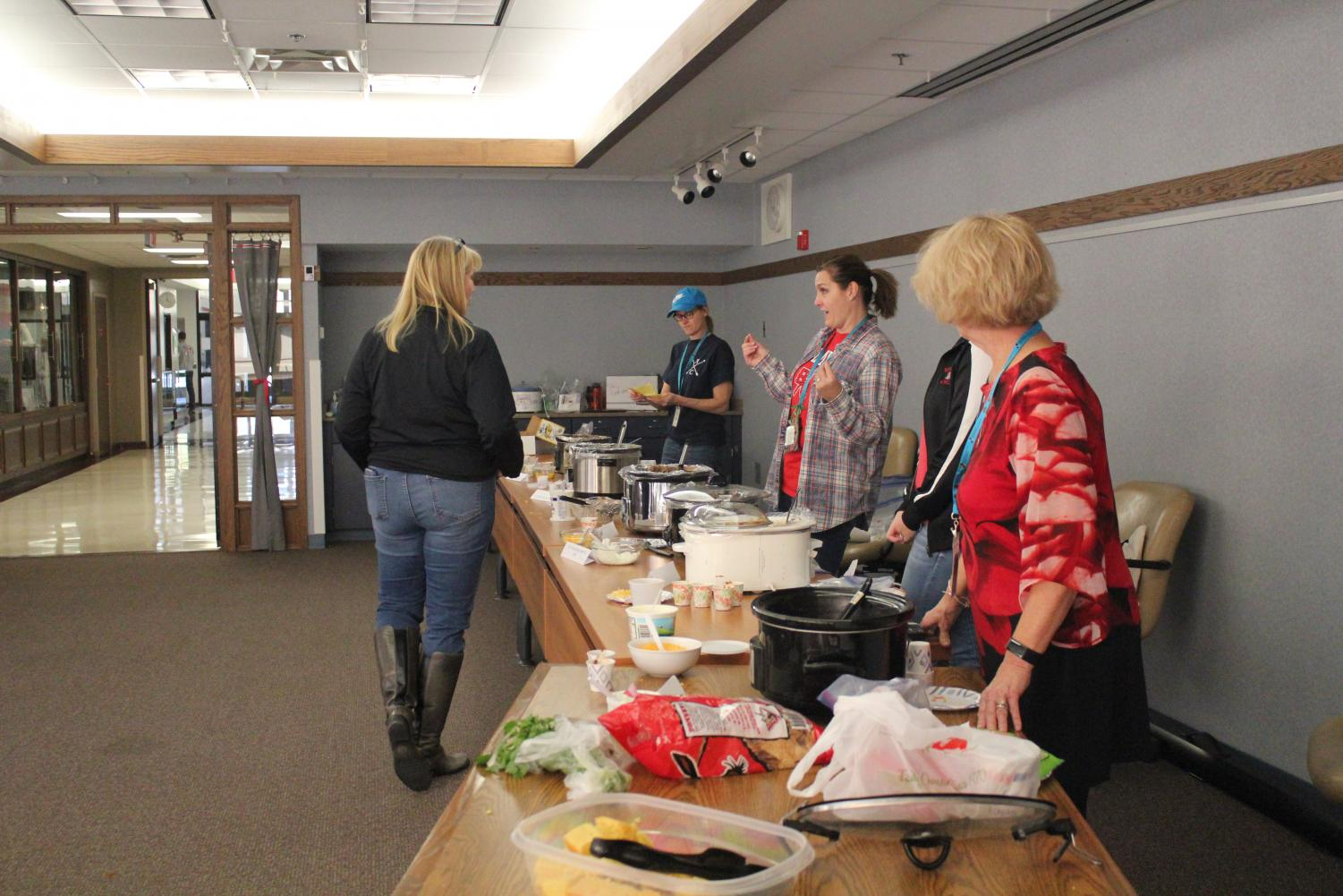 Teachers sampled chili and voted on their favorite concoction. This bake-off encourages teachers to participate in events during American Education Week.