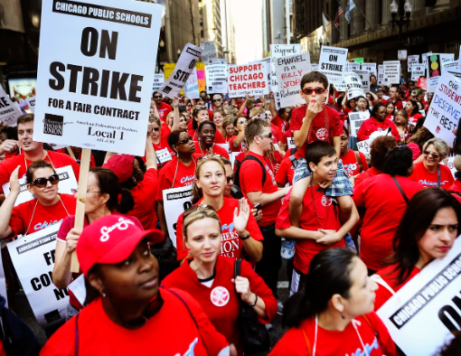 CPS teachers march down the streets of downtown Chicago to demand for better benefits and an extension of the social support network at schools.