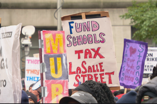 CPS staff members created picket posters to criticize the lack of funding for public schools.