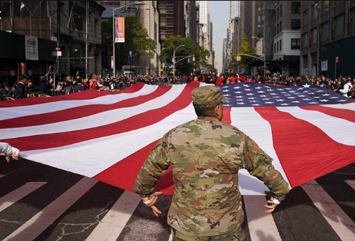 Veterans and active service members of the U.S. Armed Forces are cheered and honored by spectators at the New York City Veterans Day Parade.