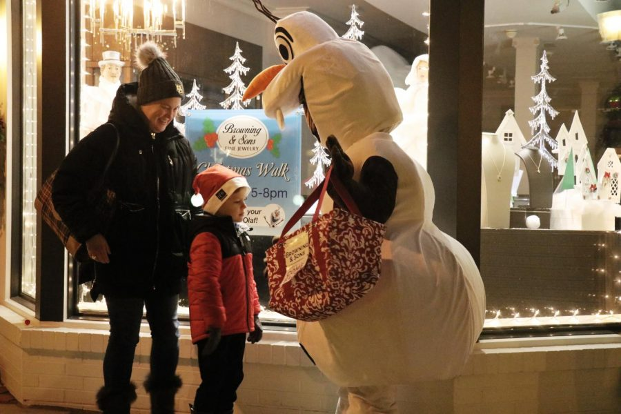 Olaf from the Frozen series made a guest appearance at the annual Christmas Walk, posing for pictures with kids and families.