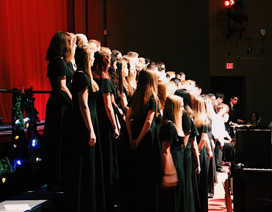 Choir director Jennifer Burkemper led Choir I, Choir II, Choir III, and the Chamber Choir to sing a variety of Christmas tunes including