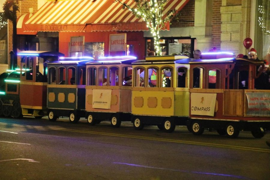 A small train drove around kids at the streets of the Christmas Walk on Friday Dec. 6.