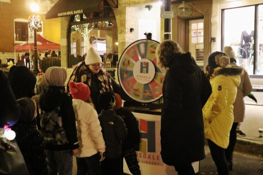 Local businesses set up booths with different games and attractions to promote their stores and services.