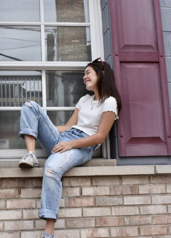 Rei Hemmer, junior, models mom jeans with white Converse, a popular fashion trend of the last decade.