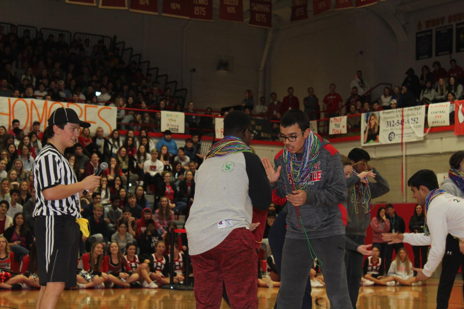 On+Friday+Jan.+9%2C+students+with+the+most+beads+at+the+end+of+spirit+week+participated+in+a+Rock+Paper+Scissor%27s+Championship+at+the+pep+rally.+The+crowd+cheered+as+sophomore+Jeremiah+Adams+won+the+final+championship.+