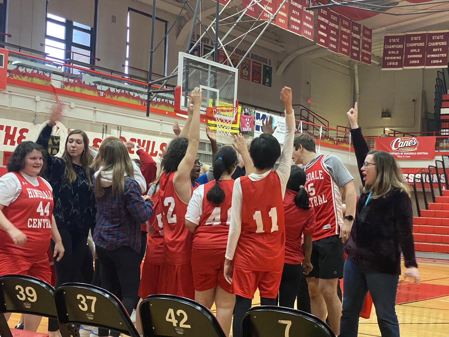 The+team+sets+up+for+success+with+a+pre-game+cheer.+Throughout+the+game%2C+the+team+members+continue+to+support+each+other+through+cheers+and+high-fives.+