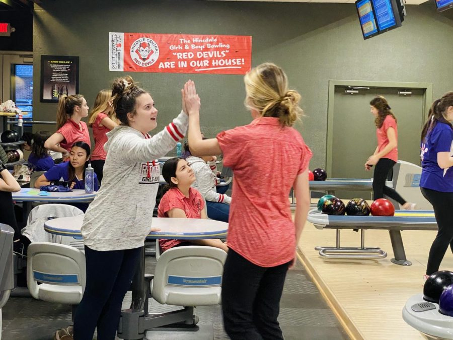 On Thursday, Jan. 9, the girls bowling team faced Downers Grove North at Suburbanite Bowl in a friendly competitive match. Teammates supported each other by giving high fives.