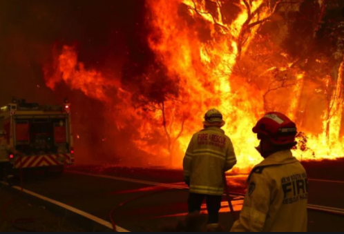 Firefighters, some sent from around the globe, battle wildfires as their flames engulf Australia.