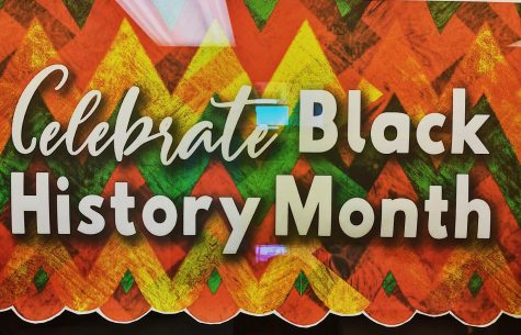 Outside of the library, Black History Month posters are displayed to celebrate diversity within Central.