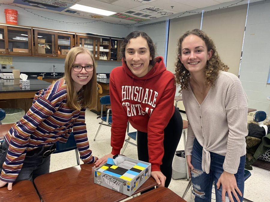 Juniors Abby Clark, Marit Ley, and Elizabeth Farah (from left to right) take on a building competition.