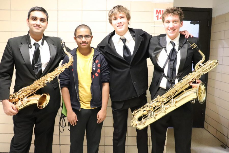 Navdeep Natt, Kolby Revord, Johnny Taylor, and Stiles Gandham displayed their instruments ready to play for Wind Ensemble.