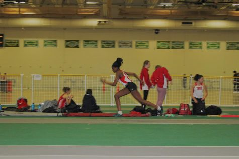 Junior Chigo Ojiako practiced her triple jump thirty minutes before the meet.