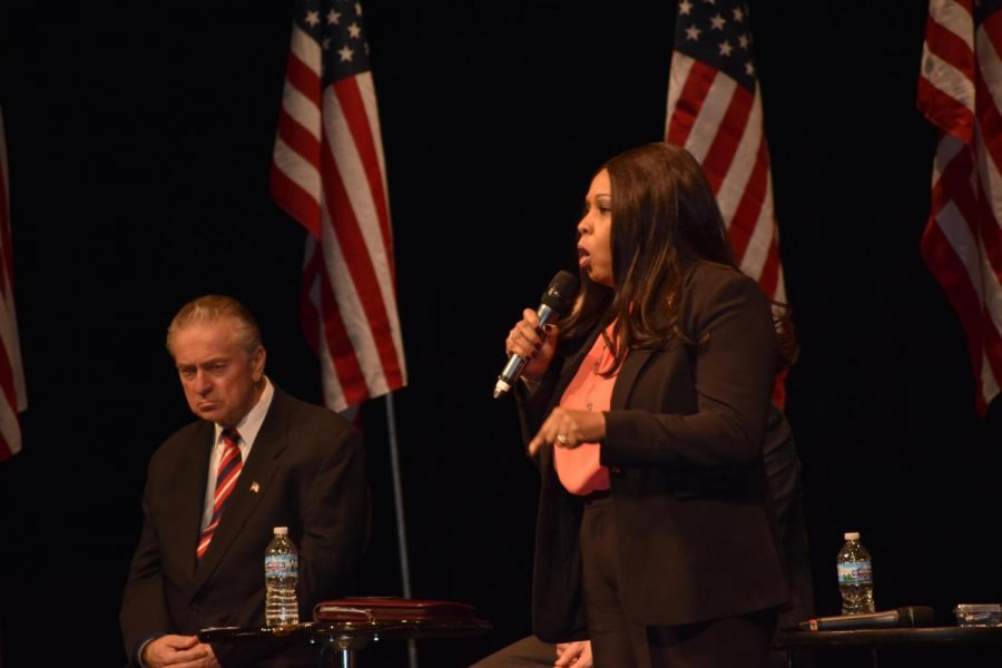 At+a+forum+in+Washington%2C+Ill.%2C+senatorial+candidate+Peggy+Hubbard+made+claims+of+bringing+a+firearm+into+Hinsdale+Central.+She+later+retracted+her+statements.