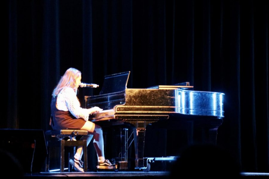 Chloe Opler, senior, sang an original song.