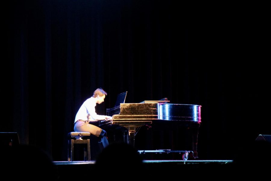 Senior Aaron Lu played an excerpt from Chopin Ballade No. 1 on the piano.