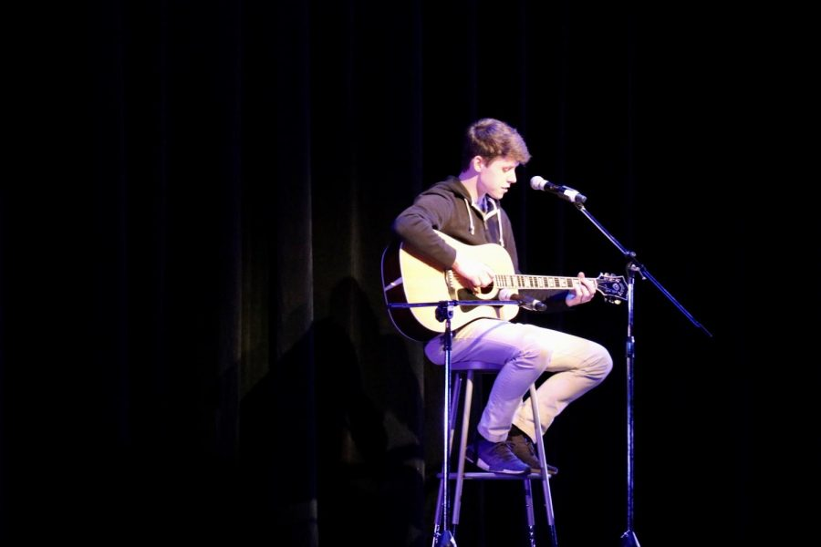Jack Doppke, junior, played guitar while singing