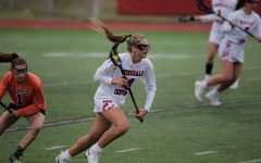 Jenna Collignon is seen sprinting across the field cradling the ball in her lacrosse stick in a game against Saint Charles during the 2019 season.