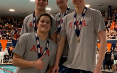 Ozgen, Cho, Cochlan, and Lahmann pose with their medals after they win first place in the 200-yard medley relay.