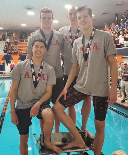 Daw, Cochlan, Tischke, and Benington win eighth place in the 400 yard free relay.