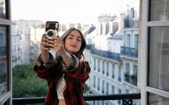 Emily taking a selfie in her new apartment in Paris to show of the view to her Instagram followers.