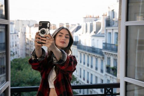 Emily takes a selfie in her new apartment in Paris to show off the view to her Instagram followers.