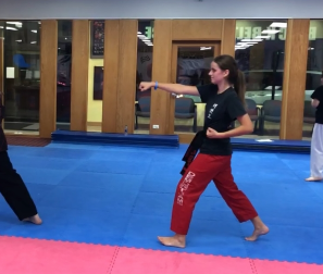 Ann Haarlow, a second-degree black belt, practices her form in preparation for her third-degree testing in the spring at Black Belt Excellence.