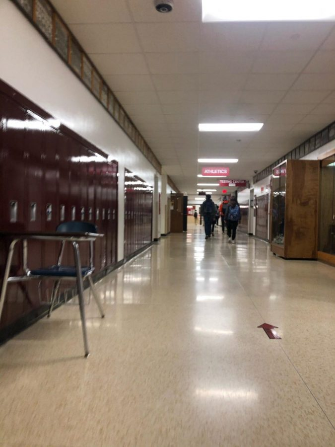 one way hallways nearly empty as students return to school in a hybrid model (credits to Faaris Hanif)