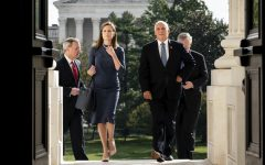 Amy Coney Barrett and Vice President Mike Pence on the steps of the Capitol before meeting with Senators Sept. 29.
