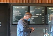 Gregory Schram, a recently retired teacher, getting a drink at Starbucks, glad he isn't still teaching.